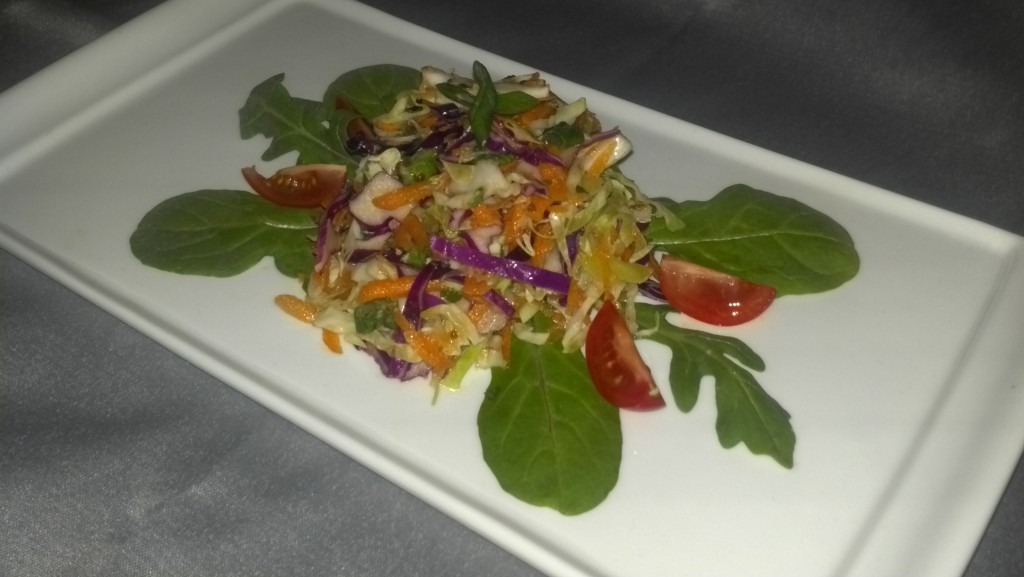 Big Easy Cabbage Slaw on baby arugula with grape tomato wedges, health, wellness, diet, dietitian, nutrition, nutritionist, michelle moreau, chef, healthy kitchen, healthcare, medical insurance, Portsmouth, NH, seacoast, celiac, cardiac, diabetes, diet, weight loss, recipe, counseling, healthcare, gluten free, vegetables, multiveggie, rainbow, side dish